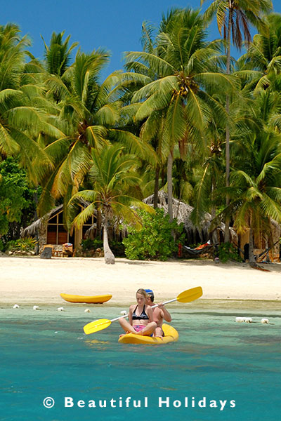 kayaking off beach in fiji islands