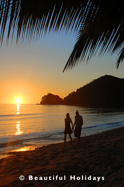 couple enjoy romantic sunset on honeymoon in fiji